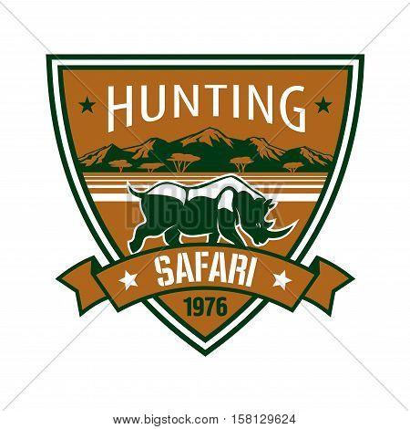 Hunting and safari badge. African rhino with mountain landscape on heraldic shield with ribbon banner. Hunting club symbol, safari trip or wildlife tourism design