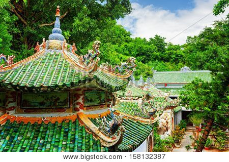 Scenic View Of Tile Roofs Of The Linh Ung Pagoda Among Woods