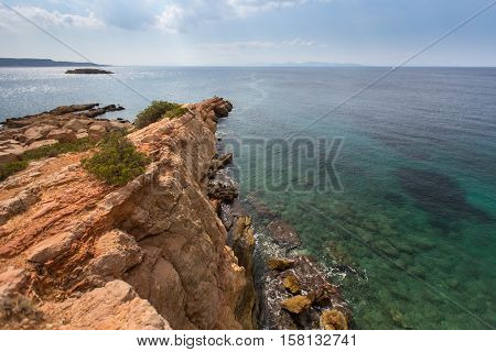 Rocky promontory in the Aegean sea near Athens.