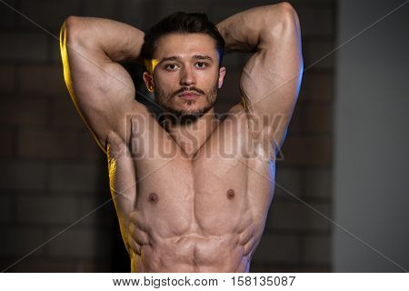 Serious Bodybuilder Standing In The Gym