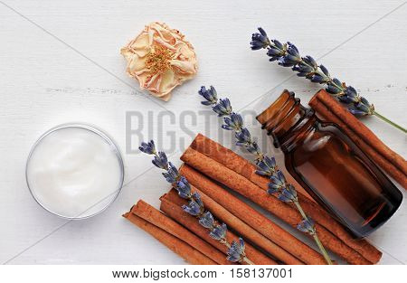 Holistic skincare cosmetic. Lavender cinnamon aromatherapy. Essential oil, facial moisturizer, dried plant ingredients. Aroma Lotion Recipe.