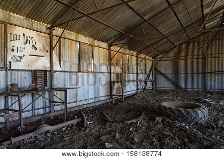 Interior of abandoned workshop at sheep station in Australian outback - Western Australia