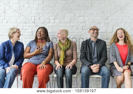 Diverse Group of People Community Togetherness Sitting