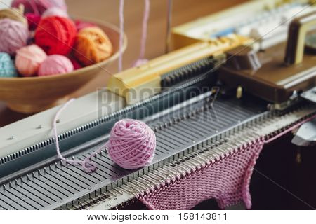 Hand Knitting Machine. A knitting machine is a device used to create knitted fabrics in a semi or fully automated fashion.