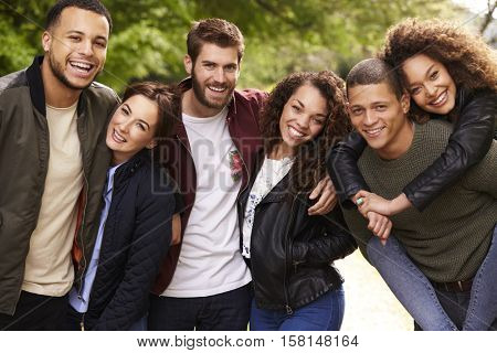 Six young adult friends on a country walk, looking to camera