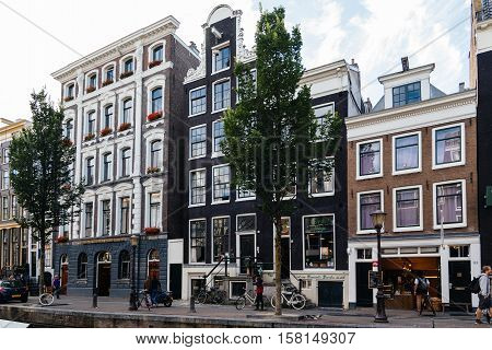 Amsterdam Netherlands - August 1 2016: Amsterdam cityscape canal houses in Red Light District