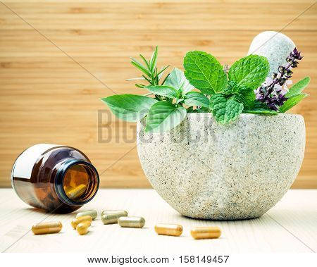 Alternative Health Care And Herbal Medicine .fresh Herbs And Herbal Capsule With Mortar And Pestle O