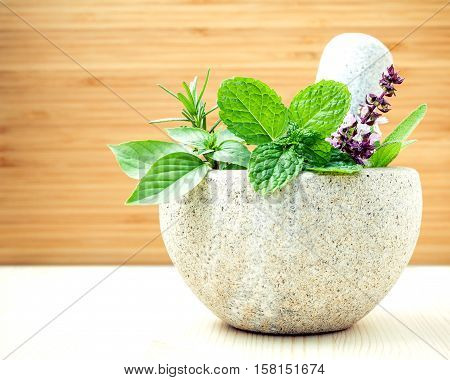 Alternative Health Care And Herbal Medicine .fresh Herbs With Mortar And Pestle On Wooden Background