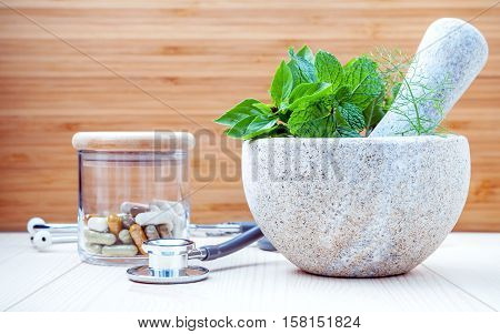 Alternative Health Care And Herbal Medicine .fresh Herbs And Herbal Capsule With Mortar And Pestle.
