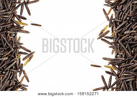 Border of black rice close-up on white background. Isolated. Decorative frame of wild brown unpolished rice.