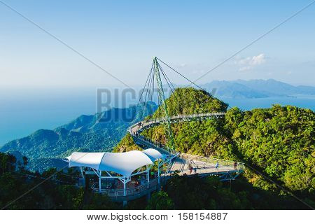 Photo of the Breathtaking aerial view with cable-stayed bridge symbol Langkawi Malaysia. Adventure holiday. Modern technology. Tourist attraction. Travel concept.
