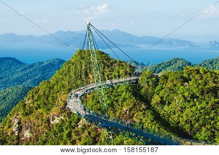Photo of the Breathtaking aerial view with Sky bridge symbol Langkawi Malaysia. Adventure holiday. Modern technology. Tourist attraction. Travel concept. Andaman sea backgroun