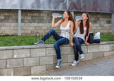 Girls drinking water a summer day