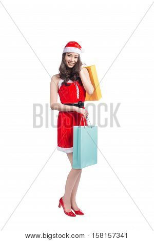 Portrait of a young smiling woman holding shopping bags before christmas