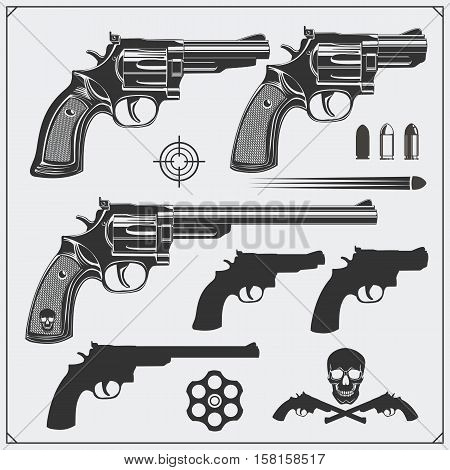 Collection of Guns. Revolvers, Bullets and target.