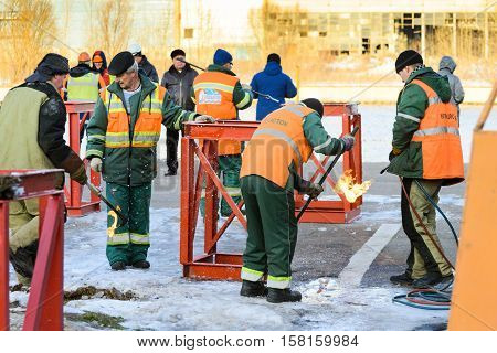 MOSCOW, RUSSIA - NOVEMBER 11, 2016: State Unitary Enterprise Mosvodostok performs recovery vessels on coastal winter parking. Workers prepare the place for the installation vessel.