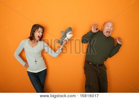 Woman Scaring Man With Fur Toy