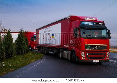 Chop, Ukraine - November 9, 2016: Trucks loaded with humanitarian aid from Hungary stand in a parking lot near the international checkpoint. Religious Communities of Hungary was sent to Ukraine of 50 tons of humanitarian aid.