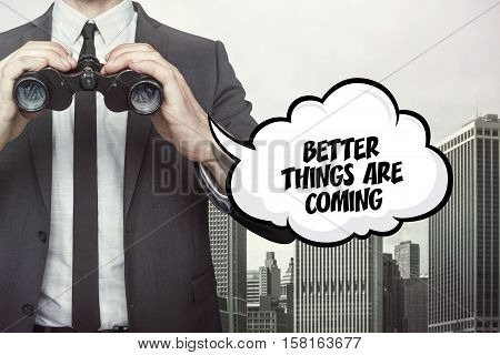 Better things are coming text on  blackboard with businessman and key