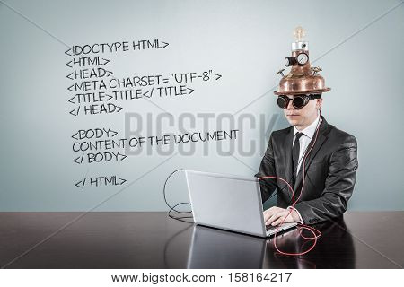 Html code text with vintage businessman using laptop at office