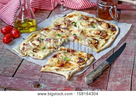 French traditional dish tarte flambee Flammekueche with goat cheese