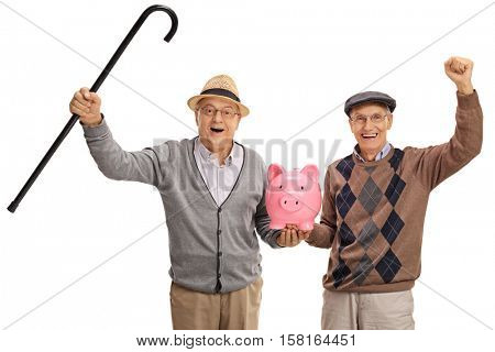 Two excited mature men holding a piggybank isolated on white background
