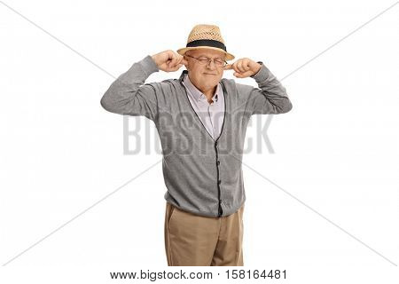 Mature man plugging his ears with his fingers isolated on white background