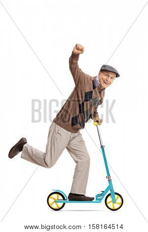 Full length portrait of an ecstatic senior riding a scooter and gesturing with his hand isolated on white background