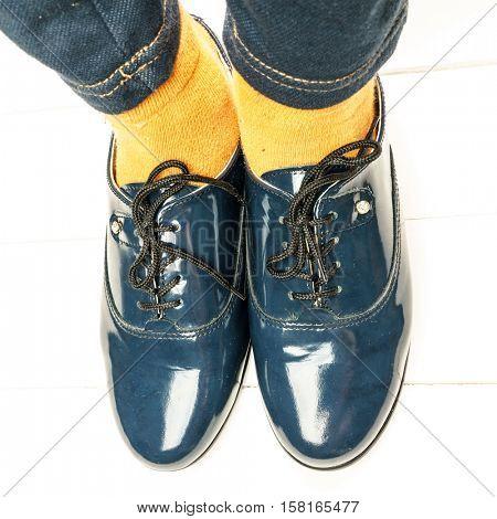 School Girl's Feet In Uniform, Schoolgirl Student is Wearing a Black Leather Shoes as a School Uiform, Cute Fashionable Design for Children and Teenage Girls, Orange Socks, Black Girls School Shoes
