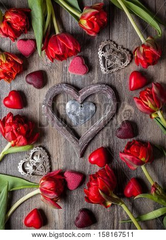 Gourmet chocolates and red tulips for Valentine's Day
