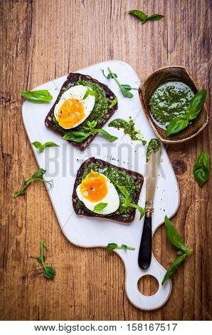 Boiled egg with pesto on toast  for breakfast