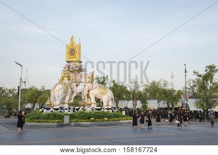 BANGKOK THAILAND - NOV 22 : people on Ratchadamnoen Nai road in sanam luang area in morning while the funeral of king Bhumibol Adulyadej in Grand Palace on november 22 2016