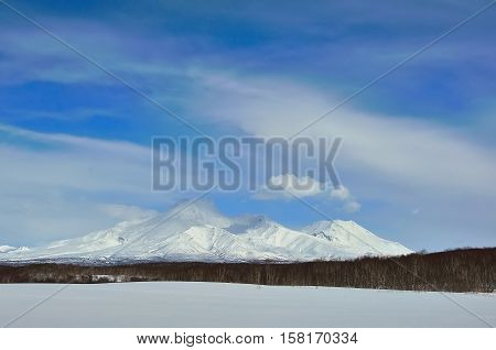 Volcanic landscape of Russia: winter view of eruption Klyuchevskoy Volcano