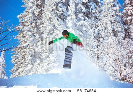 Snowboarder freeride jump in powder. Snowboarding Sheregesh snowboard and ski resort
