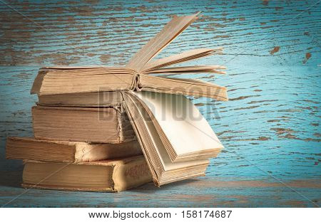 the stack of literature on the old background