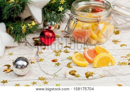 Christmas sweets under the tree on wood background
