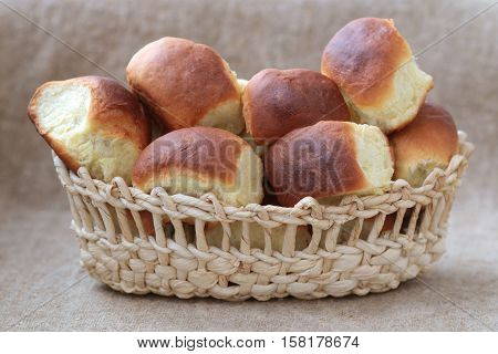 buns with cherries in wicker breadbaskets on the background from a sacking