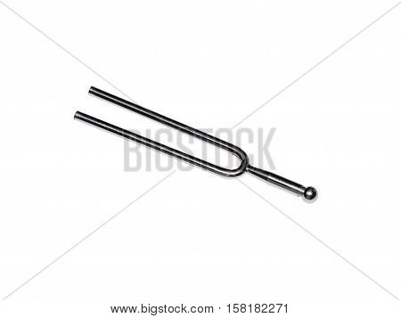 Isolated tuning fork on white background old condition