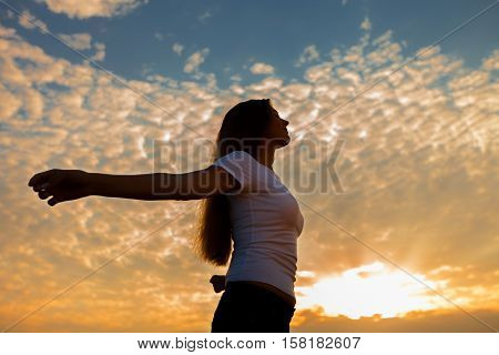 Praying / Meditating Woman at Dawn / Sunset