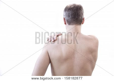 people healthcare and problem concept - unhappy man suffering from neck or shoulder pain at home