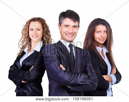 business team with pretty leader in front looking at camera and smiling