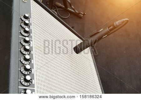 Microphone with Black Sound monitor on the stage.