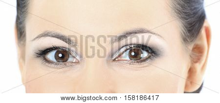 Closeup portrait of a beautiful woman. Isolated on blue background.