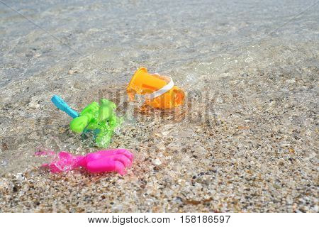 Plastic colorful toys in seawater, Ripples in the clear sea water background