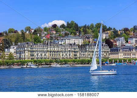 Lucerne, Switzerland - 8 May, 2016: people in boats on Lake Lucerne, buildings on the Nationalquai quay in the background. Lake Lucerne is a lake in central Switzerland, the fourth largest in the country.