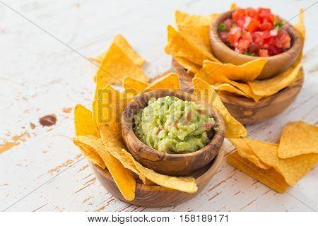 Party food - nachos with salsa and guacamole, copy space