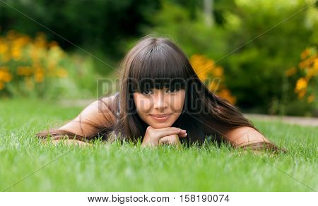 Portrait of a Young Woman Lying Down on the Grass