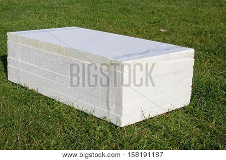 Styrofoam sheets are stacked on the grass