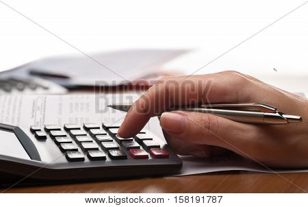 Close-up of a Woman Analyzing Financial Figures with Calculator