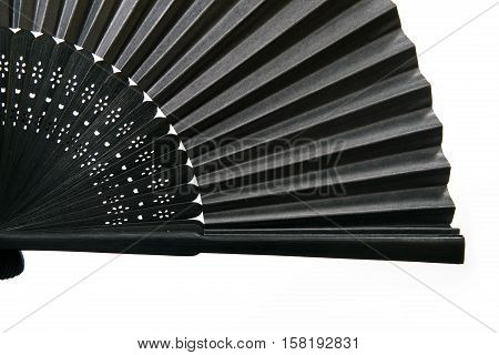 Japanese stylish black fan is isolated on a white background